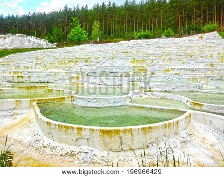 Egerszalok, Hungary - May 05, 2017: The Salt hills at Saliris resort. The Egerszalok spa pools contain water rich in calcium, magnesium, and hydrocarbonate minerals at Egerszalok, Hungary on May 05, 2017.