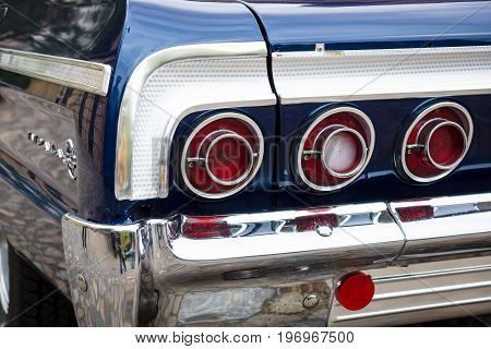 BERLIN - MAY 10 2015: The rear brake lights of a full-size car Chevrolet Impala SS. 28th Berlin-Brandenburg Oldtimer Day