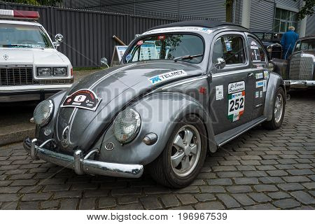 BERLIN - MAY 10 2015: Subcompact economy car Volkswagen Beetle in sports coloring. 28th Berlin-Brandenburg Oldtimer Day