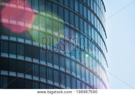a glass facade of an urban office building