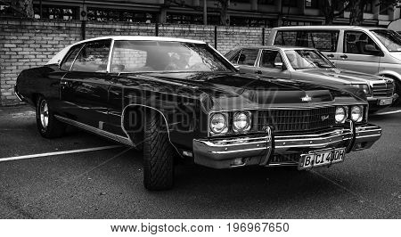 BERLIN - MAY 10 2015: Full-size car Chevrolet Caprice 1973. Black and white. 28th Berlin-Brandenburg Oldtimer Day