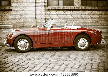 BERLIN - MAY 10 2015: Sports car Austin-Healey Sprite Mk I. Stylization. Vintage toning. Side view. 28th Berlin-Brandenburg Oldtimer Day