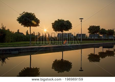 Sunset on a promenade near a new construction area in viersen, germany