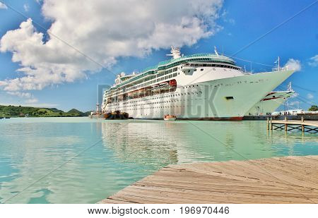 A cruise ship docked on the tropical island of St. Johns Antigua