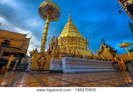 The golden pagoda in twilight . At Wat Phra That Doi Suthep temple is tourist attraction of Chiang Mai, Thailand.