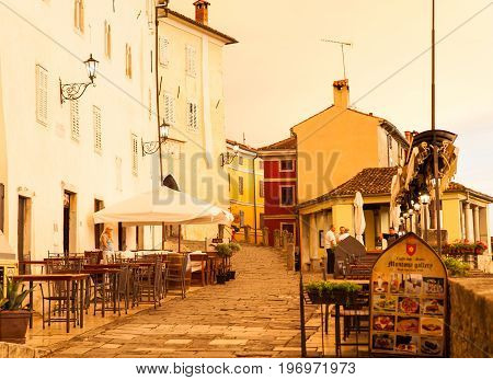 MOTOVUN, CROATIA - JULY, 12: View of Motovun town street at sunset on July 12, 2017