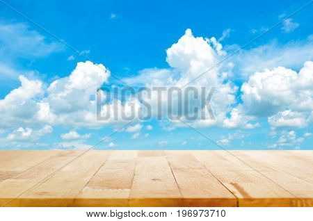 Wood table top on summer blue sky background - can be used for display or montage your products