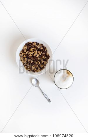 Top View Of Glass Of Coffee Latte And Cornflakes In Bowl With Spoon, Isolated On White