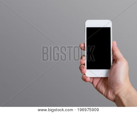 Hand Holding Blank Black Screen Smart Phone (mobile Phone) At Dark Grey Background,mock Up For Displ