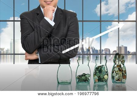 Businessman with Step of coins bottle in office conference meeting room on photo blurred cityscape Business investment growth concept