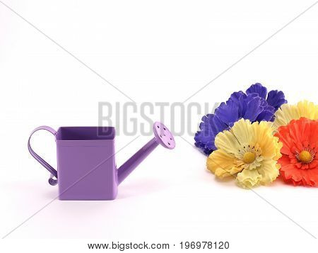 small purple metal watering can and colorful artificial fabric flowers on white background, home decor cute for nature lovers