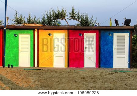 Bright colorful beach cabins in Rimini Emilia-Romagna Italy.