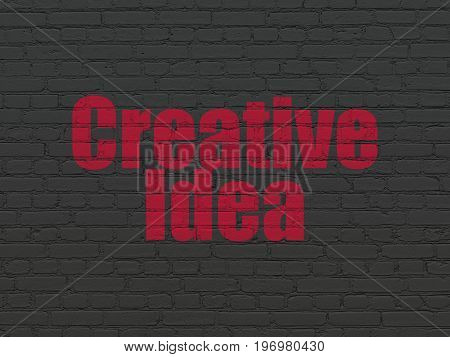 Business concept: Painted red text Creative Idea on Black Brick wall background