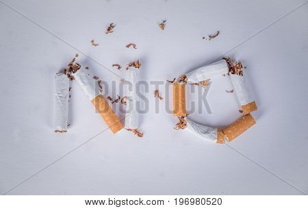 No smoking sign with cigarette on a grey background