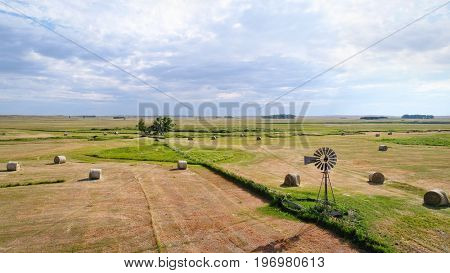 hay bales and windmill in Nebraska Sandhills -aerial view