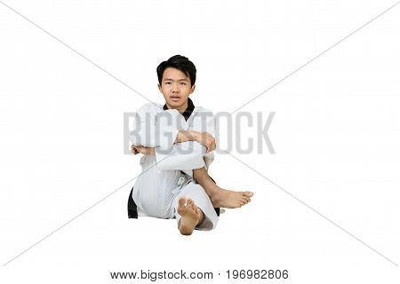 Portrait Of An Asian Professional Taekwondo Black Belt Degree (dan) Stretching His Body. Isolated Fu
