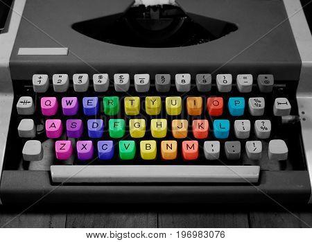black and white typewriter with rainbow keys