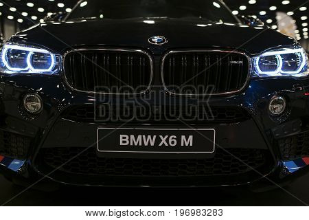Sankt-Petersburg Russia July 21 2017: BMW X6M 2017. Headlight of a modern sport car. Front view of luxury sport car. Car exterior details. Photo Taken on Royal Auto Show July 21