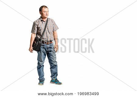Portrait Of A Happy Mature Man Standing In Scott Shirt And Blue Jeans Looking To The Right Side. Iso