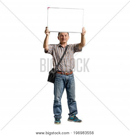Portrait Of A Happy Mature Man Standing In Scott Shirt And Blue Jeans Holding The Blank Message Boar