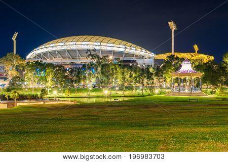 Adelaide Australia - April 16 2017: Adelaide Oval with Elder Park Rotunda illuminated at night time
