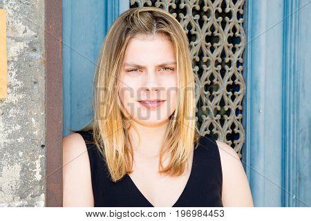 Blonde Teen Girl On Blue Background Door