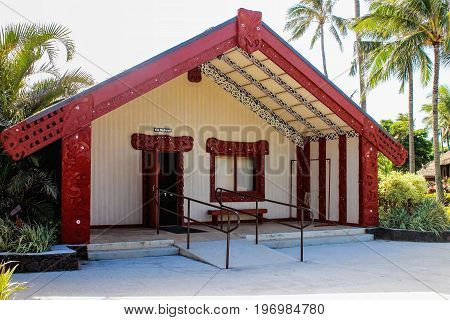 Honolulu Hawaii - May 27 2016: A traditional Maori Meeting house inside the Aotearoa village at the Polynesian Cultural Center a popular tourist attraction on Oahu.
