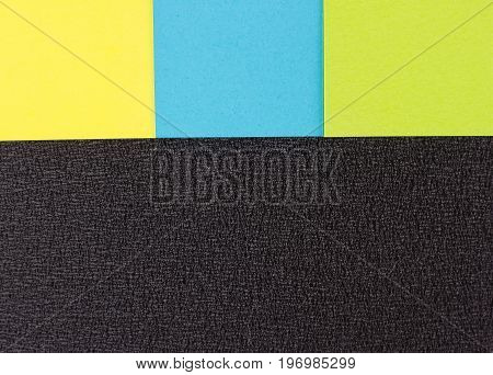 background of colored stickers on the black