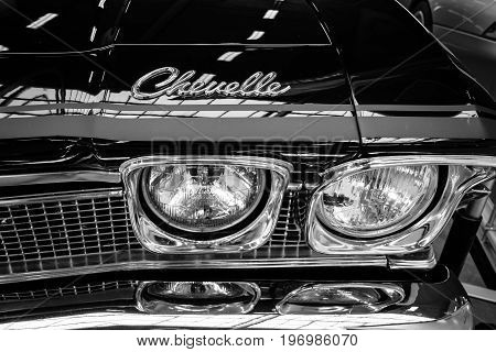 PAAREN IM GLIEN GERMANY - MAY 23 2015: Headlamp of a mid-size car Chevrolet Chevelle. Black and white. The oldtimer show in MAFZ.