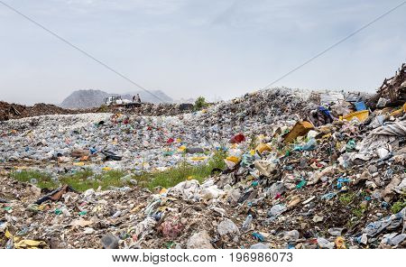 uncontrolled waste dumping landfill with open burning site