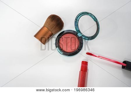 close up isolated cheek brush and brush on with red matte lip gloss