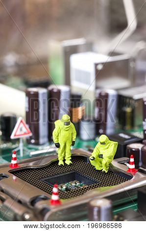 Toy technicians are repairing or diagnosing a motherboard. Under Construction concept. Selective focus.