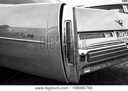 PAAREN IM GLIEN GERMANY - MAY 23 2015: Fragment of a full-size luxury car Cadillac Coupe de Ville. Black and white. The oldtimer show in MAFZ.