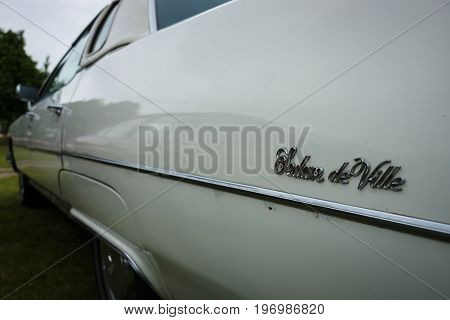 PAAREN IM GLIEN GERMANY - MAY 23 2015: Fragment of a full-size luxury car Cadillac Sedan de Ville. The oldtimer show in MAFZ.