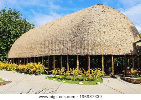 Honolulu Hawaii - May 27 2016: A Traditional Samoan Guest house a fale talimalo within the Samoan village at the Polynesian Cultural Center.