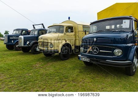 PAAREN IM GLIEN GERMANY - MAY 23 2015: Trucks Daimler-Benz L323 Mercedes-Benz LA 710 Daimler-Benz LAF 311/36 and MAN 620 L1. The oldtimer show in MAFZ.