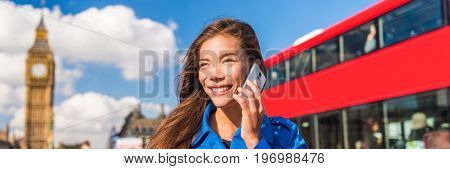 London tourist Asian woman talking on phone banner. Urban businesswoman calling cellphone, red bus and Big Ben, Parliament urban background. Europe destination, England, Great Britain.