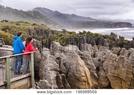 Punakaiki Pancake Rocks tourists couple travel in Paparoa National Park, West Coast, South Island, New Zealand