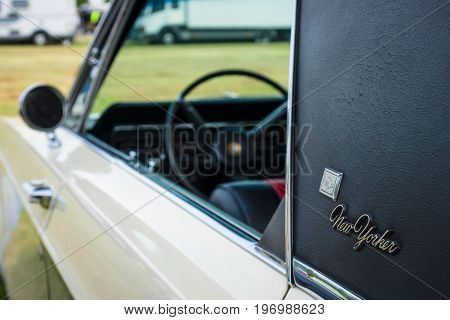 PAAREN IM GLIEN GERMANY - MAY 23 2015: Fragment of a vintage car Chrysler New Yorker 1965. The oldtimer show in MAFZ.
