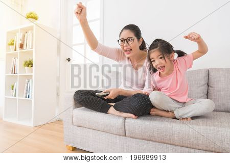 Woman With Children Watching Tv Sports Channel