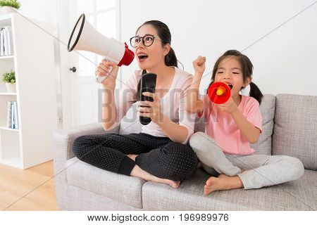Young Mom And Daughter Through Megaphone
