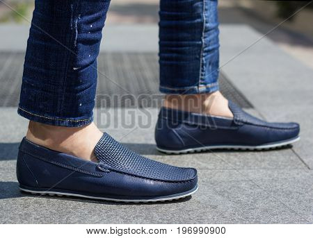 Blue leather moccasins on a man. Shoes for men