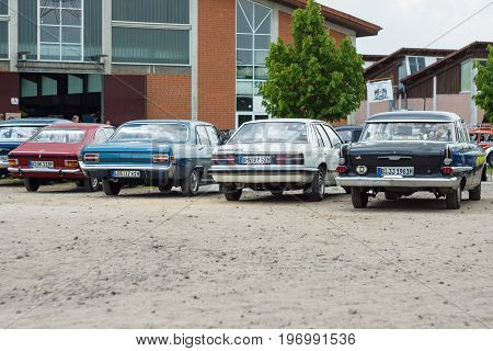 PAAREN IM GLIEN GERMANY - MAY 23 2015: Various models of the Opel stand in a row. Rear view. The oldtimer show in MAFZ.