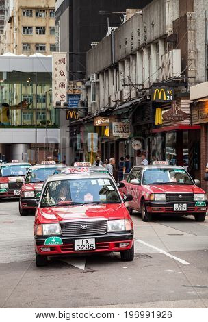 Red Toyota Comfort Taxicabs Go On The Street