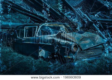 Old rusty classic car from the fifties submerged under water