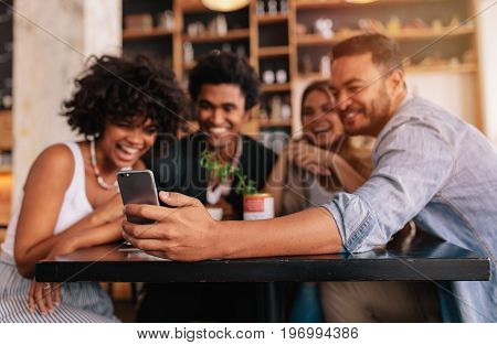 Group Of Friends Making A Self Portrait With Mobile Phone