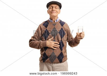 Satisfied senior with a glass of water holding his hand on his stomach isolated on white background