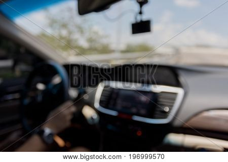 blur image chauffeur driver taxi driving car on road city