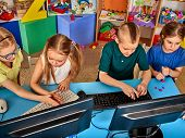Children computer class us for education and video game. Boys and girls in children's club who spend many hours behind computer monitor harmful to health. Computer safety training for children. poster