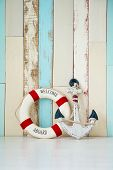 Composition on the marine theme with anchor and lifeline on wooden background. poster
